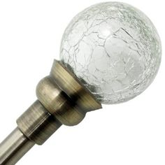 glue christmas ornaments on your curtain rod for perfect mercury