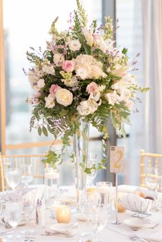 Classically elegant centerpiece: http://www.stylemepretty.com/illinois-weddings/chicago/2015/02/09/vintage-inspired-chicago-wedding-2/ | Photography: Tamara Gruner - http://tamaragruner.com/
