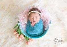 Spring look with tulips for newborn girl by Boston newborn photographer, Isabel Sweet of iSweet Photography. #newborn #girl #spring #flowers