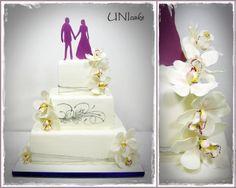 H20. Valkoinen-violetti-hopea hääkakku orkideoilla koristeltuna. White, violet and silver wedding cake with cymbidium orchids.