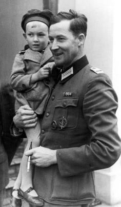 """Wilhelm Hosenfeld, who was awarded the Iron Cross during the First World War, and was called up to serve in the German army again in 1939.   He is the real life German officer who saved musician Władysław Szpilman (from the movie """"the pianist""""  He died in a Russian prison camp in 1952 of a ruptured Aortic Aneurysm ( a particularly bloody and painful way to die). He is depicted here with one of his children."""