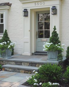 I love curb appeal projects! For Susan's beautiful home, I added lanterns from McLean Lighting, and selected Farrow and Ball Blue Gray 91 for the front door. Planters are from Restoration Hardware (entrance step curb appeal) Front Door Planters, Building A Porch, Exterior Front Doors, Door Planter, Porch Steps, Curb Appeal, House Front, Ranch Style Homes, House Exterior