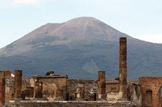 Pompeii, Italy  It was Romans when buried in 79AD by a cataclysmic eruption from Mount Vesuvius (seen in the distance), the preserved site as rediscovered in1599.