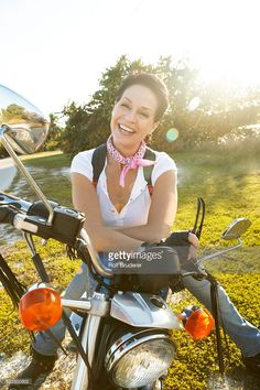 Smiling Woman with Motorcycle