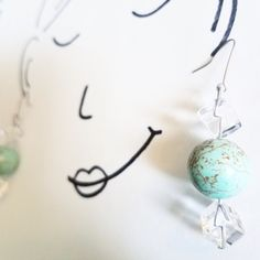 Turquoise and gold speckled round beads and clear cubes dangle