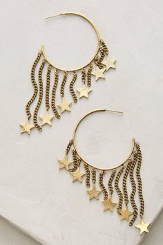 31045970c8b4 Make a statement for the fall with a set of these dangling gold star hoop  earrings