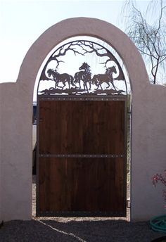 Ultimate Freedom Gate.  Wooden and Steel entry gate.  Hand plasma cut steel horses.