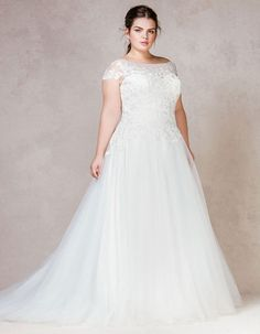 Make An Entrance In This Romantic A Line Gown Dreamy Tulle Falls To The Floor And Soft Illusion Neck Has Been Finished With Delicate Embroidered