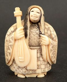 Ivory Netsuke of Noh Actor.  Face reverses to reveal a demon face.  www.ephemeritor.com