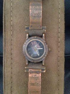Watchcraft watch, designed by Eduardo Milieris. Copper, brass, steel.
