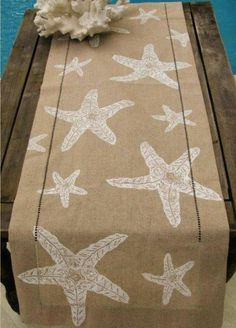 Cute starfish table runner from Caron's Beach House Decor Take some starfish stamp the burlap use and a table runner