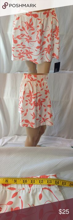 Women's Lily's of Beverly Hills Mini Skirt NWT NWT Lily's of Beverly Hills Mini Skirt Peach and White in color size small Lily's of Beverly Hills Skirts Mini