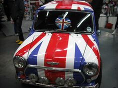 The British Mini, a great British style icon. Between 1959 and 2000, 5,387,862 Minis had been manufactured, making it by far the most popular British car ever made. Rule, Britannia!