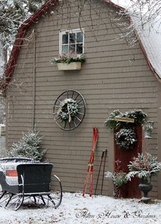 wheel and wreath on barn