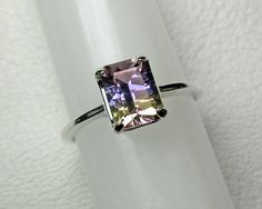 Hey, I found this really awesome Etsy listing at https://www.etsy.com/listing/222799363/ametrine-ring-in-silver-8-x-6-mm