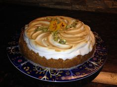 Creamy cake with Italian merinque and pistachio on top of it.