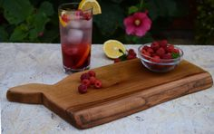 This unique wooden cutting board could be a great addition to your kitchen. Each cutting board is completely handmade and with precision to detail. To make it, we have used a piece of high quality recycled beech wood finished with hand rubbed linseed oil. This cutting board is food safe - only natural materials are used - wood and linseed oil. You can use it also as a serving platter.  Size approximately: length: 14,43 in.(37cm.) width: 6,24 in.(16cm.) height: 0,97 in.(2.5cm.)
