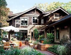 This seems to me to look like Craftsman met Cape Cod, love the garden sitting area!