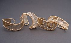 Gold kinetic Cuffs by Tana Acton. I have several of her pieces.
