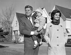 John F. Kennedy with Jacqueline and daughter Caroline outside their home in Hyannisport in 1960.