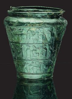 Vače situla. 6th-5th century BC. The Vače Situla is one of the oldest old Slovenian symbols from the 6th century BC. It was found in the village Vače near the Geometric Centre of Slovenia, at the important archaeological site from the Iron Age. At the spot where the situla was found there's an enlarged replica now, while the original can seen at the National Museum of Slovenia in Ljubljana