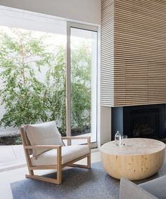 Wood surround on fire place - wood table - Alfred Street Residence by Studio Four | Remodelista