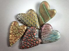 Hearts by Dr. Ron Lehocky using Kor Tool designs Metal Clay Jewelry, Leather Jewelry, Valentines Day Hearts, Polymer Clay Beads, Stone Painting, Tool Design, Make And Sell, Rock Art, Painted Rocks