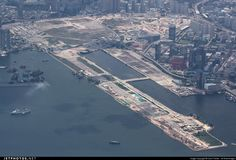 7/19/2010 - By 2012, the fuel-soaked soil was flushed out. In June 2013, the Kai Tak Cruise Terminal was opened on the tip of the former runway. Two public housing estates opened on the northeast area of the site in 2013, providing over 13,000 new rental flats. As of August 2014, the checkerboard remains visible, though with strong natural overgrowth obscuring much of its facade. A few buildings have been erected on the north eastern part of the apron creating the Kai Ching Estate. Kai Tak Airport, Cathay Pacific, August 2014, Photo Online, International Airport, Helicopters, Planes, Hong Kong, Facade