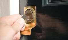 Person putting key in keyhole