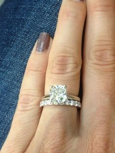 My dream set - although I would like a thinner eternity band. Cushion cut 2 carat solitaire ring with eternity wedding band