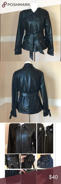 Belted Faux leather jacket Women's black faux leather jacket. Quilt and stitch pattern. Zip-up with top and bottom snap closures. Detachable leather belt, 2 side snap pockets, adjustable silver metal buckles on sleeves for a perfect fit and added style. Excellent condition Jackets & Coats