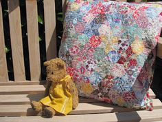 My English paper pieced stars and hexagons have finally been made into something. Smaller and more humble than the fragile, but sizeable, . Crochet Fabric, Crochet Quilt, Felt Fabric, Liberty Quilt, Liberty Fabric, Cushion Inspiration, Cushion Ideas, Printed Cushions, Liberty Of London