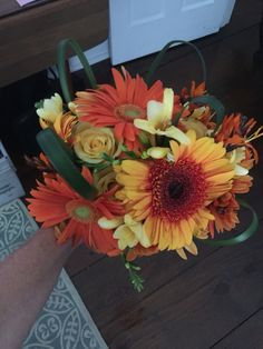 Orange and yellow wedding bouquet by Reynolds Treasures
