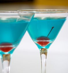 Grey Goose Vodka and Hypnotiq over ice, shake and strain into martini glasses.Addone cherry and serve! For a tropical twist, add a dash of pineapple juice!