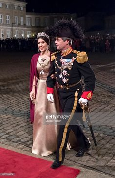 Crown Prince Frederik, and Crown Princess Mary of Denmark arrive at the Traditional New Year's Banquet hosted by Queen Margrethe of Denmark, at, Amalienborg Palace, on January 1, 2017, in Copenhagen, Denmark. (Photo by Julian Parker/UK Press via Getty Images)
