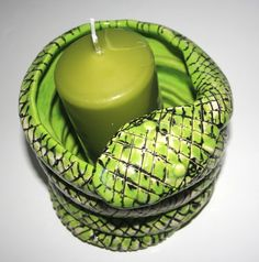 Handmade ceramic snake candle holder