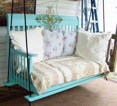 An old crib upcycled to a new porch swing...