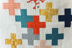 I love this version of plus quilt with lots of negative space. Pins and Bobbins.
