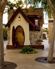 Storybook style playhouse - love the oval door!