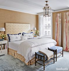 In the master bedroom, walls in Madison Sheer by Rose Tarlow Melrose House and a headboard covered in Lee Jofa's La Fiorentina stand in for the warmth of curtains. Embroidered bed linens from Julia B. and vintage stools covered in Jasper's Remy.   - HouseBeautiful.com