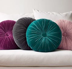 Round throw pillows in different colors...