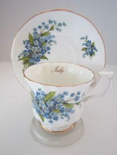 ROYAL DOVER Tea Cup and Saucer LARKSPUR Flower Gold Colored Trim Made in England #BritishColonial #RoyalDover