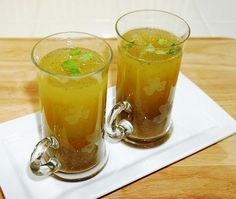 Masala Soda ♦ Sugar syrup - 6 big teaspoon (of normal strength - according to taste),  Lime Juice - 1 whole,  Black pepper powder - 1/4 tbsp,  Chat Masala - 2 tpsp,  Black Salt - 1/2 tbsp,  Crushed Ice,  Soda water,  Tall glass,  Mixing pitcher,  Lime Slice (For garnishing)