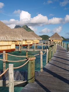 Bora Bora - ooh make ours the second bungalow on the left. The South Pacific islands are high up on our bucket list.