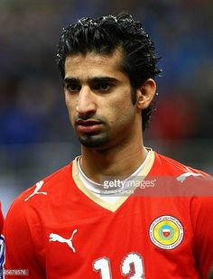 Mahmood Abdulrahman of Bahrain lines up for national anthems during the 2010 FIFA World Cup Asian qualifier match between Japan and Bahrain at...