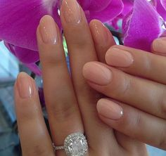 Cute nude pink on rounded natural nails.