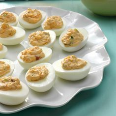 Mexican Deviled Eggs Recipe -With two young children, my husband and I live on a beautiful lake and host lots of summer picnics and cookouts. I adapted this recipe to suit our tastes. Folks who are expecting the same old deviled eggs are surprised when they try this delightful tangy variation. -Susan Klemm, Rhinelander, Wisconsin