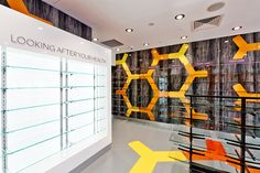 In 2013, Davidson developed a new brand identity for Slade Pharmacy. The opening of a new site in Camberwell provided the perfect opportunity to bring the new identity to life.  The brand hexagon, brand colours and wayfinding signage system were all utilised to create a vibrant and thoroughly modern retail experience, that challenges category conventions.