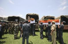 Soldiers load flag-draped coffins containing the bodies of rescue personnel who died in a chopper crash onto vehicles after a guard of honour ceremony in Dehradun in Uttarakhand June 28, 2013. Posted by floodlist.com #floods #Uttarakhand