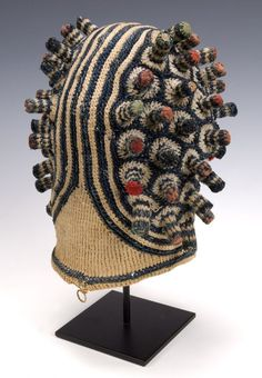 Africa | Bamileke Titleholder's Hat. Cameroon Grasslands | Early 20th century | Materials; Cotton, trade wool, wood pegs ~ Crochet technique